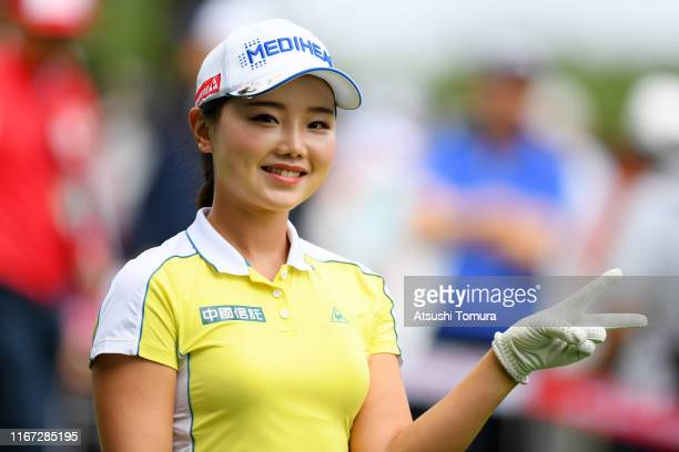 Yuting Seki of China poses after hitting her tee shot on the 1st hole during the final round of the Hokkaido meiji Cup at Sapporo International...