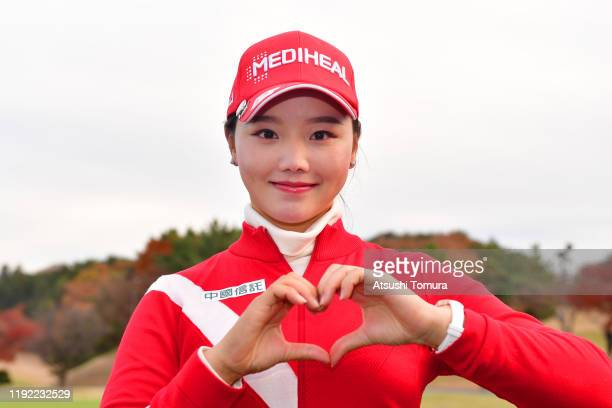 Yuting Seki of China poses for photographs after the final round of the Japanese LPGA Final Qualifying Tournament at Kodama Golf Club on December 6,...