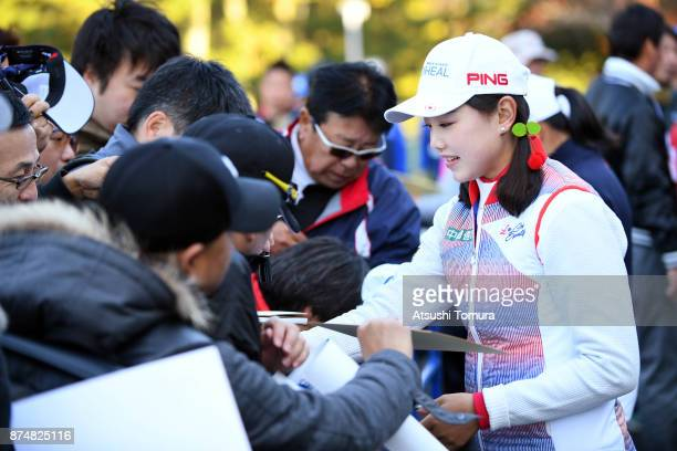 Yuting Seki of China signs autograph for fans during the first round of the Daio Paper Elleair Ladies Open 2017 at the Elleair Golf Club on November...