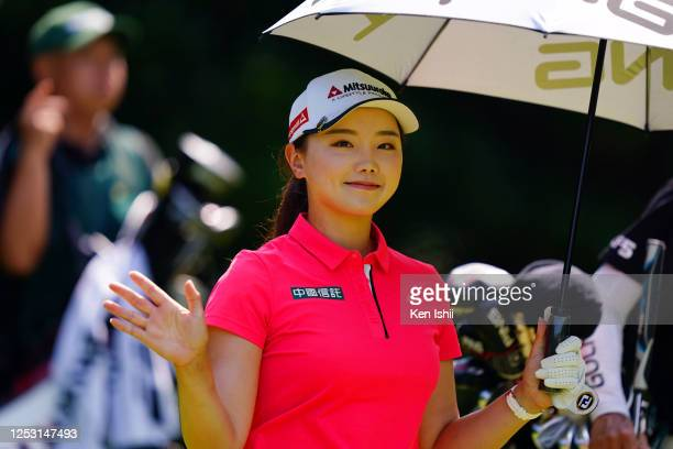 Yuting Seki of China smiles after her tee shot on the 4th hole during the final round of the Earth Mondamin Cup at the Camellia Hills Country Club on...