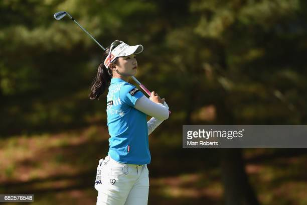 Yuting Seki of China watches her approach shot on the 4th hole during the second round of the HokennoMadoguchi Ladies at the Fukuoka Country Club...