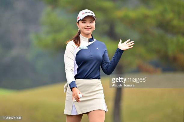 Yuting Seki of China waves on her way to the 2nd tee during the final round of the TOTO Japan Classic at the Taiheiyo Club Minori Course on November...