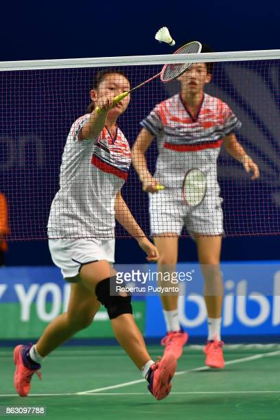 Yuting Xia and Zhang Shuxian of China compete against Tan Pearly Koong Le and Toh Ee Wei of Malaysia during Women's Doubles Round 16 match of the BWF...