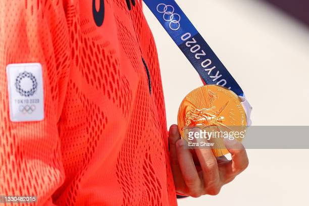 Yuto Horigome of Team Japan shows his gold medal at the Skateboarding Men's Street Finals medal ceremony on day two of the Tokyo 2020 Olympic Games...