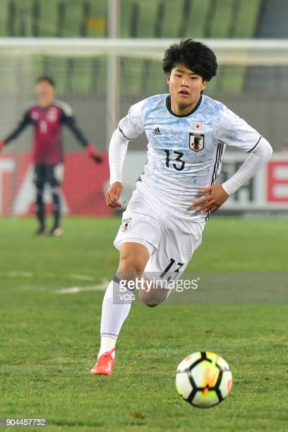 Yuto Iwasaki of Japan drives the ball during the AFC U23 Championship Group B match between Thailand and Japan at Jiangyin Stadium on January 13 2018...