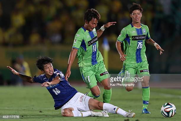 Yuto Misao of Shonan Bellmare is tackled by Kentaro Sato of JEF United Chiba during the J League second division match between Shonan Bellmare and...