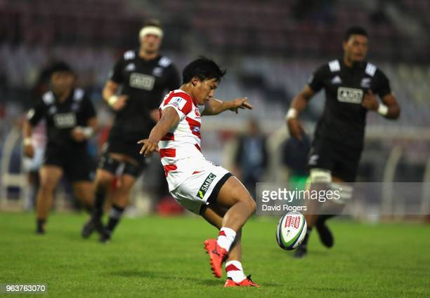 Yuto Mori of Japan kicks the ball upfield during the World Rugby U20 Championship match between New Zealand and Japan at Stade d'Honneur du Parc des...