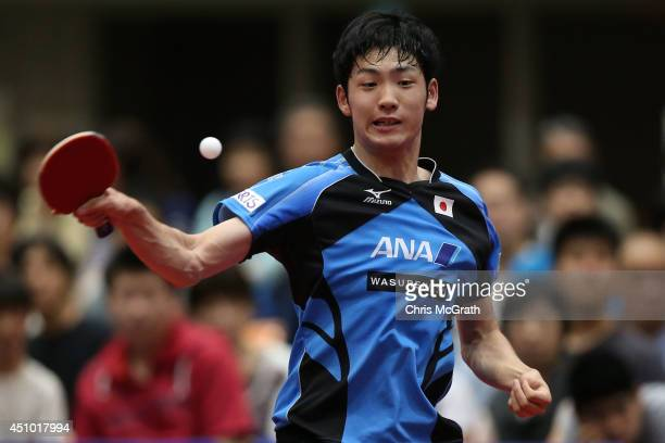 Yuto Muramatsu of Japan returns a shot against Jun Mizutani of Japan during their Men's Singles Semi final match on day three of 2014 ITTF World Tour...