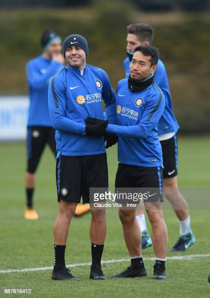 Yuto Nagatomo and Citadin Martins Eder of FC Internazionale joking during an FC Internazionale training session at Suning Training Center at Appiano...