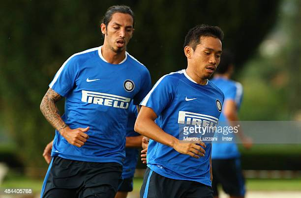 Yuto Nagatomo and Ezequiel Schelotto of FC Internazionale Milano run during FC Internazionale training session at the club's training ground on...