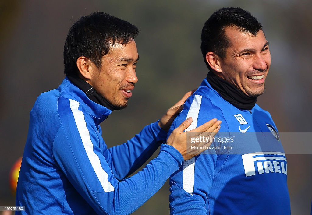 Yuto Nagatomo and Gary Alexis Medel of FC Internazionale Milano look on during the FC Internazionale training session at the club's training ground on December 3, 2015 in Appiano Gentile Como, Italy.