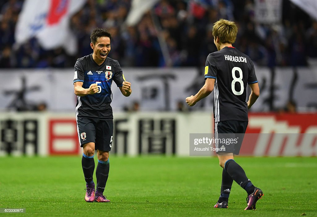 Yuto Nagatomo and Genki Haraguchi of Japan celebrates their 2-1 win during the 2018 FIFA World Cup Qualifier match between Japan and Saudi Arabia at Saitama Stadium on November 15, 2016 in Saitama, Japan.