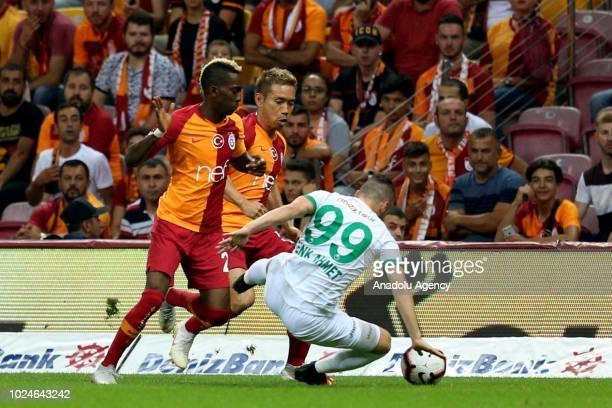 Yuto Nagatomo and Henry Onyekuru of Galatasaray in action against Cenk Ahmet Alkilic of Aytemiz Alanyaspor during Turkish Super Lig soccer match...