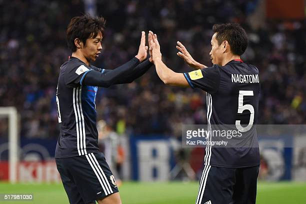 Yuto Nagatomo and Hiroshi Kiyotake of Japan celebrate their team's fifth goal during the FIFA World Cup Russia Asian Qualifier second round match...
