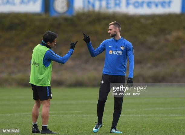 Yuto Nagatomo and Marcelo Brozovic of FC Internazionale in action during an FC Internazionale training session at Suning Training Center at Appiano...