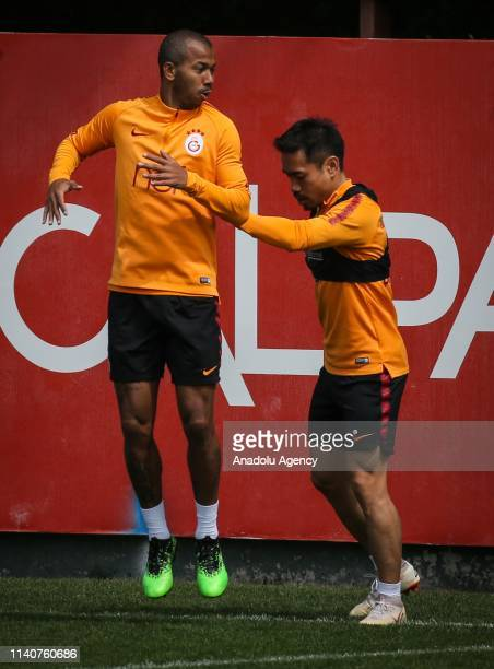 Yuto Nagatomo and Mariano Ferreira Filho of Galatasaray attend a training session ahead of the Turkish Super Lig derby between Galatasaray and...