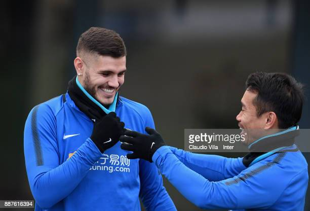 Yuto Nagatomo and Mauro Icardi of FC Internazionale chat during an FC Internazionale training session at Suning Training Center at Appiano Gentile on...