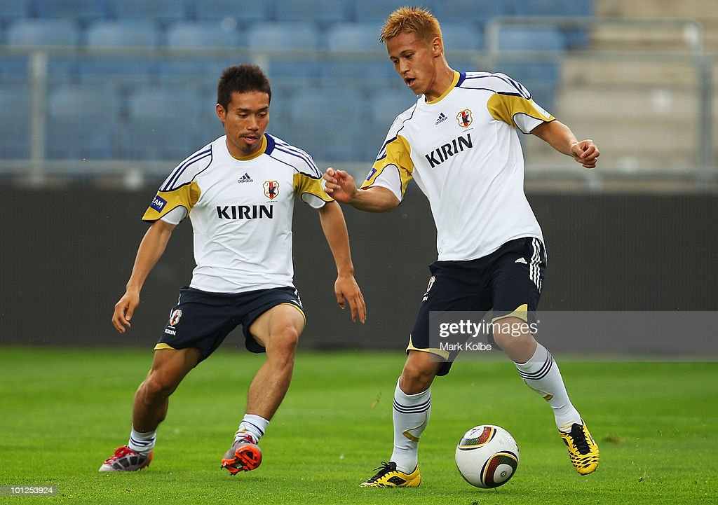 Yuto Nagatomo competes for the ball with Keisuke Honda during a Japan training session at UPC-Arena on May 29, 2010 in Graz, Austria.
