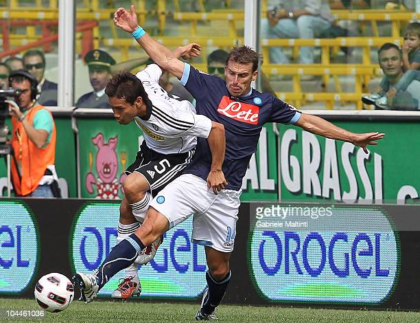 Yuto Nagatomo of AC Cesena battles for the ball with Hugo Campagnaro of SSC Napoli during the Serie A match Cesena and Napoli at Dino Manuzzi Stadium...
