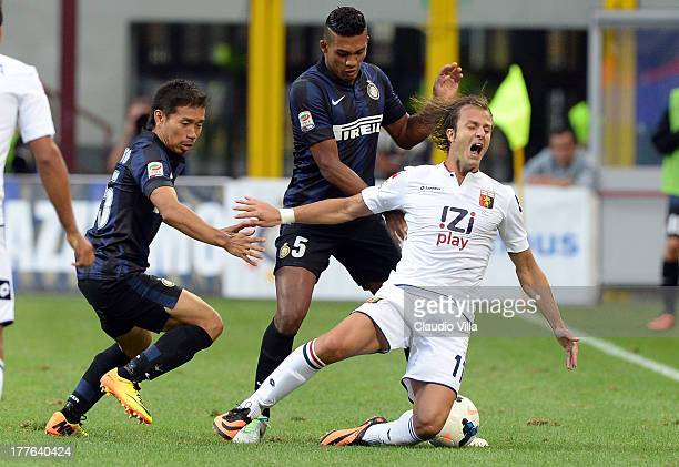 Yuto Nagatomo of FC Inter Milan and Alberto Gilardino of Genoa CFC compete for the ball during the Serie A match between FC Internazionale Milano and...