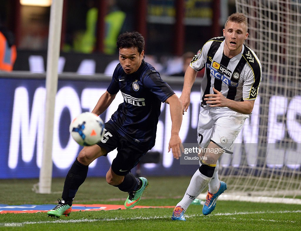 Yuto Nagatomo of FC Inter Milan and Silvan Widmer of Udinese Calcio (R) compete for the ball during the Serie A match between FC Internazionale Milano and Udinese Calcio at San Siro Stadium on March 27, 2014 in Milan, Italy.