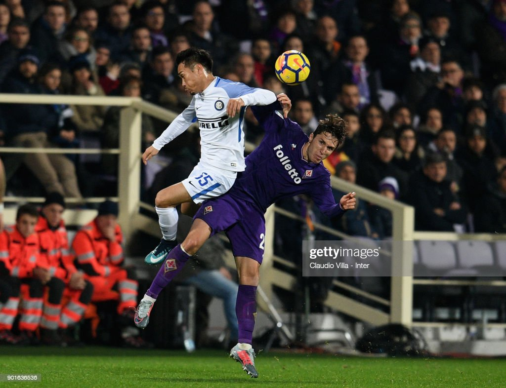 Yuto Nagatomo of FC Internazionale (L) and Federico Chiesa of AFC Fiorentina compete for the ball during the serie A match between ACF Fiorentina and FC Internazionale at Stadio Artemio Franchi on January 5, 2018 in Florence, Italy.