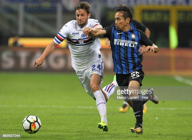 Yuto Nagatomo of FC Internazionale competes for the ball with Bartosz Bereszynski of UC Sampdoria during the Serie A match between FC Internazionale...