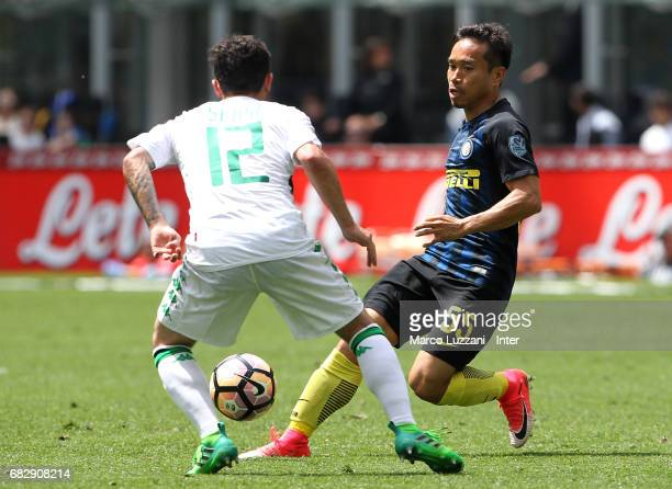 Yuto Nagatomo of FC Internazionale competes for the ball with Stefano Sensi of US Sassuolo during the Serie A match between FC Internazionale and US...
