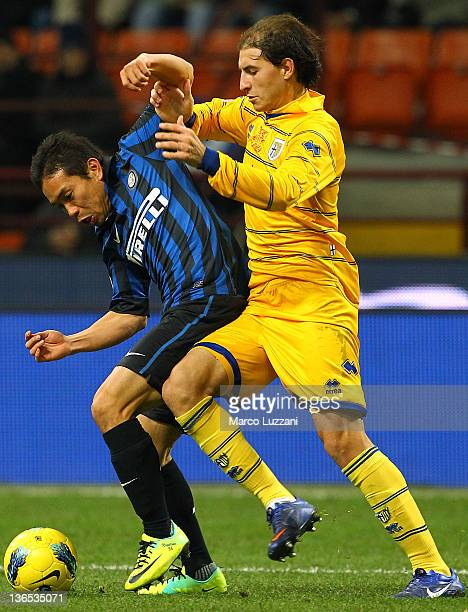 Yuto Nagatomo of FC Internazionale Milano battles for the ball with Gabriel Paletta of Parma FC during the Serie A match between FC Internazionale...