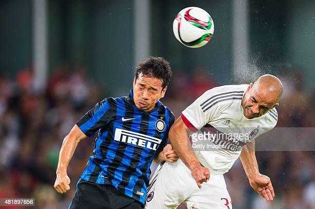 Yuto Nagatomo of FC Internazionale Milano competes for the ball with Alex Rodrigo Dias da Costa of AC Milan during the AC Milan vs FC Internacionale...