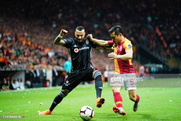 Yuto Nagatomo of Galatasaray and Ricardo Quaresma of Besiktas challenging for the ball during the Turkish Super Lig match between Galatasaray SK and...