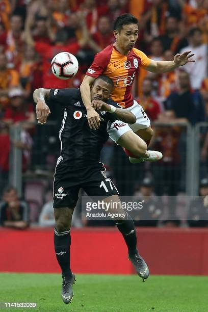 Yuto Nagatomo of Galatasaray in action against Jeremain Lens of Besiktas during the Turkish Super Lig week 31 football match between Galatasaray and...