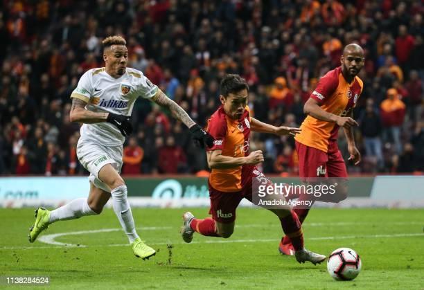 Yuto Nagatomo of Galatasaray in action against Tjaronn Chery of Istikbal Mobilya Kayserispor during Turkish Super Lig soccer match between...