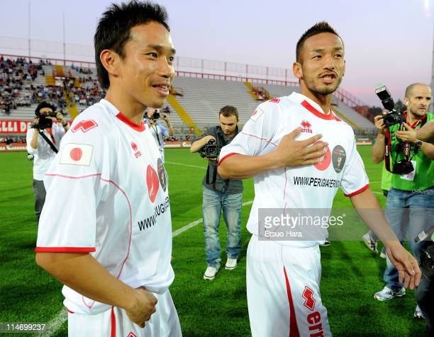 Yuto Nagatomo of Inter and former football player Hidetoshi Nakata talk prior to the charity match 'Perugia Per Sendai' at Renato Curi Stadium on May...