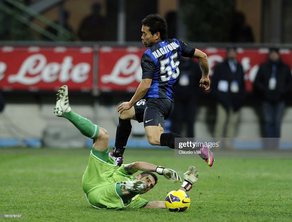Yuto Nagatomo of Inter Milan and goalkeeper Christian Puggioni of AC Chievo Verona in action during the Serie A match between FC Internazionale Milano and AC Chievo Verona at San Siro Stadium on February 10, 2013 in Milan, Italy.