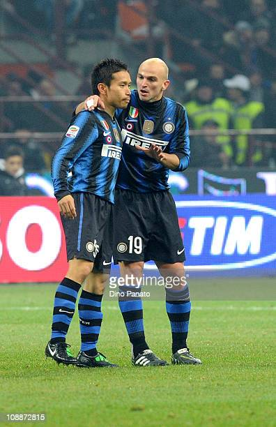 Yuto Nagatomo of Inter Milan speaks with Esteban Cambiasso during the Serie A match between F C Internazionale Milano and AS Roma at Stadio Giuseppe...