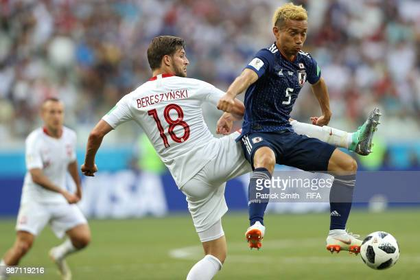 Yuto Nagatomo of Japan and Bartosz Bereszynski of Poland battle for the ball during the 2018 FIFA World Cup Russia group H match between Japan and...