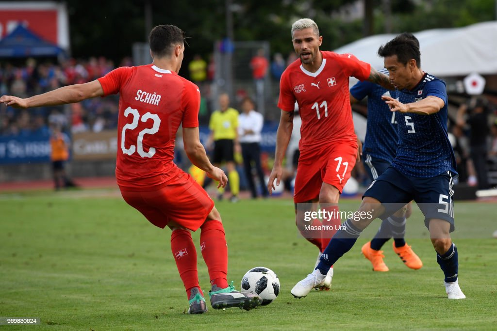 Yuto Nagatomo of Japan (R) and Schaer Fabian of Switzerland (L) compete for the ball during the international friendly match between Switzerland and Japan at the Stadium Cornaredo on June 8, 2018 in Lugano, Switzerland.