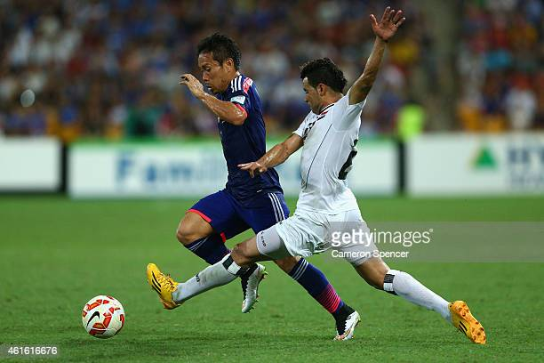 Yuto Nagatomo of Japan and Waleed Salem AlLami of Iraq contest the ball during the 2015 Asian Cup match between Iraq and Japan at Suncorp Stadium on...