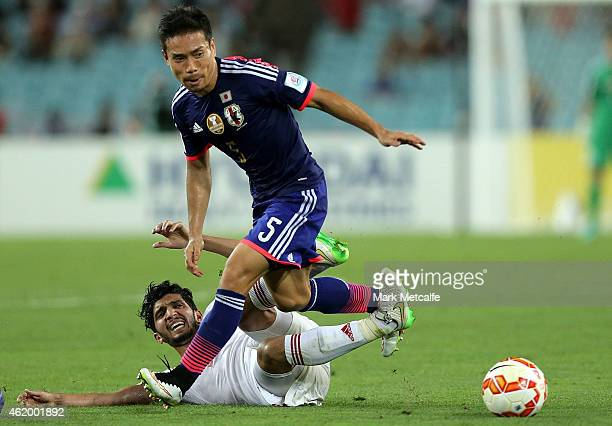 Yuto Nagatomo of Japan competes with Amer Abdulrahman of the United Arab Emirates during the 2015 Asian Cup Quarter Final match between Japan and the...