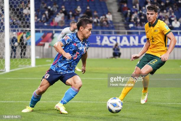 Yuto Nagatomo of Japan controls the ball under pressure of Fran Karacic of Australia during the FIFA World Cup Asian qualifier final round Group B...