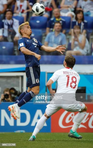 Yuto Nagatomo of Japan in action against Bartosz Bereszynski of Poland during the 2018 FIFA World Cup Russia Group H match between Japan and Poland...
