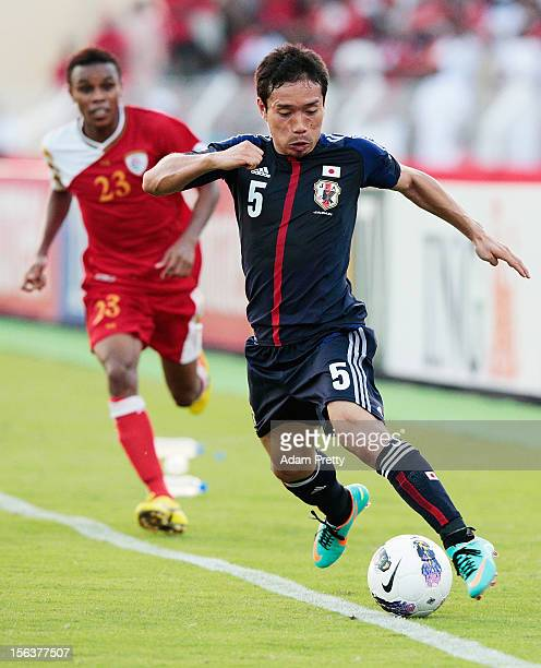 Yuto Nagatomo of Japan in action during the FIFA World Cup Asian qualifier match between Oman and Japan at Sultan Qaboos Sports Complex on November...