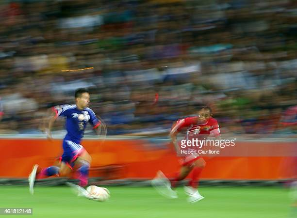 Yuto Nagatomo of Japan is chased by Munther Abu Amarah of Jordan during the 2015 Asian Cup match between Japan and Jordan at AAMI Park on January 20...