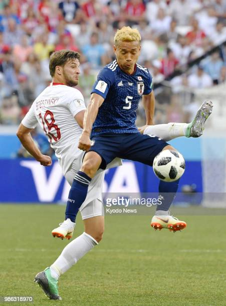 Yuto Nagatomo of Japan is marked by Bartosz Bereszynski of Poland during the second half of a World Cup Group H match between the two countries in...