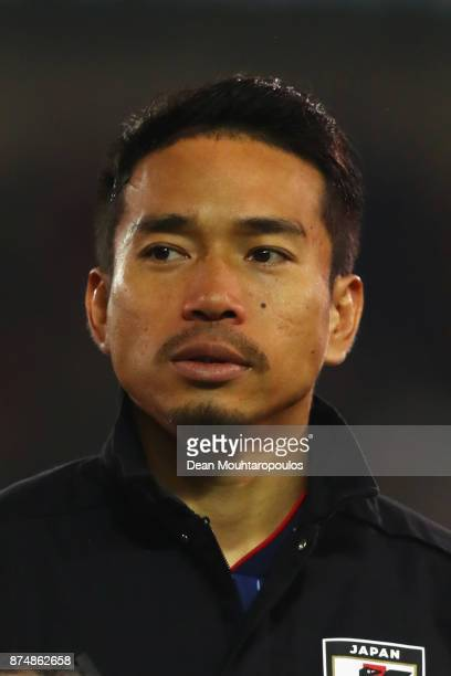 Yuto Nagatomo of Japan lines up for the national anthem prior to the international friendly match between Belgium and Japan held at Jan Breydel...