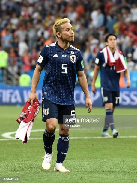 Yuto Nagatomo of Japan looks dejected following his sides defeat in the 2018 FIFA World Cup Russia Round of 16 match between Belgium and Japan at...