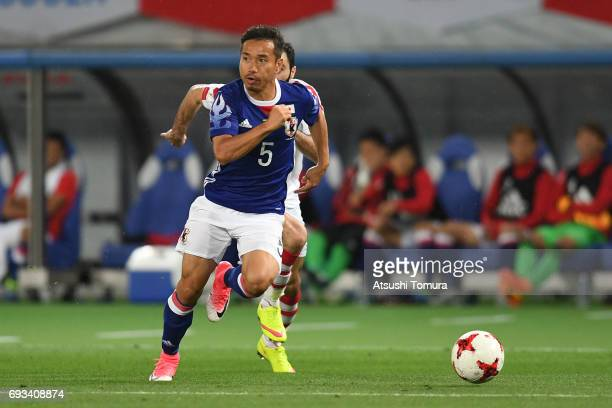 Yuto Nagatomo of Japan runs with the ball during the international friendly match between Japan and Syria at Tokyo Stadium on June 7 2017 in Chofu...