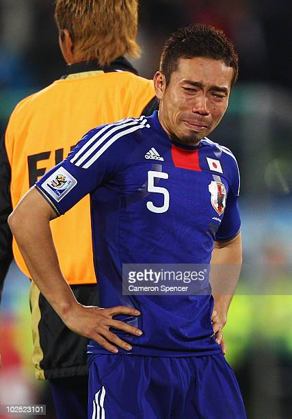 Yuto Nagatomo of Japan shows his dejection after losing a penalty shootout during the 2010 FIFA World Cup South Africa Round of Sixteen match between...