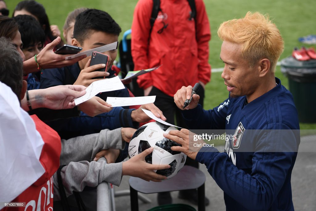 Yuto Nagatomo of Japan signs autographs after a training session on June 14, 2018 in Kazan, Russia.